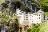 Predjama castle inside the mountain — Photo