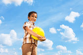 Boy standing with football ball — Stock Photo