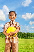 Boy holding yellow volleyball — Stock Photo