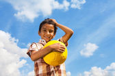 Boy with ball over sky — Stock Photo