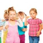 Kids brushing teeth — Stock Photo #42492921