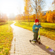 Little boy riding a scooter — Stock Photo