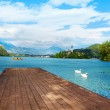 Wood pier on the Bled lake — Stock Photo