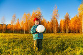 Ittle boy holding a white ball — Stock Photo