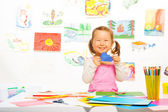 Beautiful girl with color paper — Stock Photo