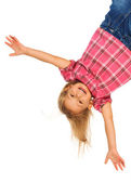 Girl hanging upside down — Stock Photo