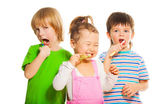 Kids brushing teeth — Stock Photo