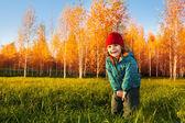 Happy child in autumn park — Stock Photo