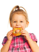 Little girl eating bread ring — Стоковое фото