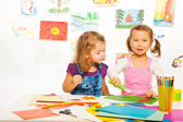 Little girls with color paper — Stock Photo