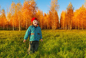 Happy child in autumn park — Stock Photo