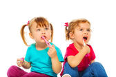 Little girls with toothbrush — Stock Photo