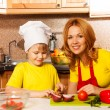 Boy with his mother in the kitchen — Stock Photo #44547957