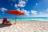 Orange beach umbrella — Stock Photo