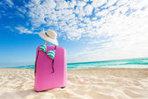 Baggage bag with swimsuit bikini and straw hat — Stockfoto