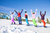 Skier and snowboarders in the mountains — Stock Photo
