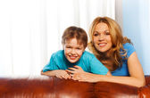 Boy and his mother cuddling each other — Stock Photo