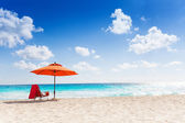 Orange beach umbrella — Stock Photo