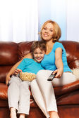 Mother with her son are watching television — Foto Stock