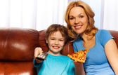 Boy and his mother eating pizza — Stock Photo