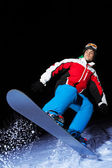 Snowboarder in action during jump — Stock Photo
