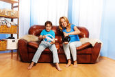 Mother and child playing with steering wheels — Stok fotoğraf