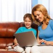 Mother and son with laptop — Stock Photo #47609789