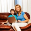 Mother and son with laptop — Stock Photo #47609803