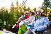 Four snowboarders — Stockfoto