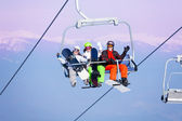 Snowboarders   on ropeway — Stock Photo