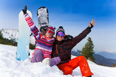 Couple with snowboards — Stock Photo