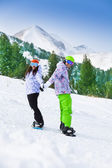 Couple standing on snowboards — Stock Photo
