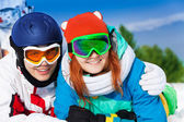 Man and woman in ski masks — Stock Photo