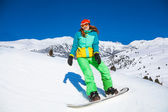 Girl  on snowboard — Stock Photo