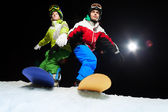 Two snowboarders — Stockfoto