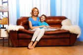Mother and child  on couch — Stock Photo