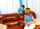 Mother and son with laptop — Stock Photo