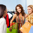 Women  with shop assistant — Stock Photo #47610809