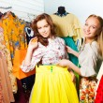 Two women choosing   skirt — Stock Photo #47610849
