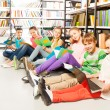 Six  children  in library — Stock Photo #47611553