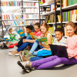 Children   in library — Stock Photo #47611575