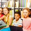 Five  children  in library — Stock Photo #47611579