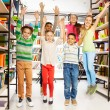 Kids jumping  in  library — Fotografia Stock  #47611747
