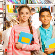 Girl and boy with books — Stockfoto