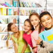 Four kids with books — Foto Stock