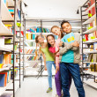 Four kids with books — Stockfoto