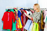 Girl choosing clothes — Stock Photo