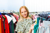 Woman chooses clothes — Stock Photo