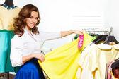 Girl choosing  skirt — Stock Photo