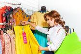 Girl chooses  skirt — Stockfoto